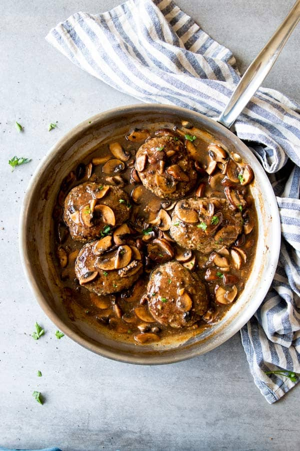 Salisbury steak in mushroom gravy in a skillet
