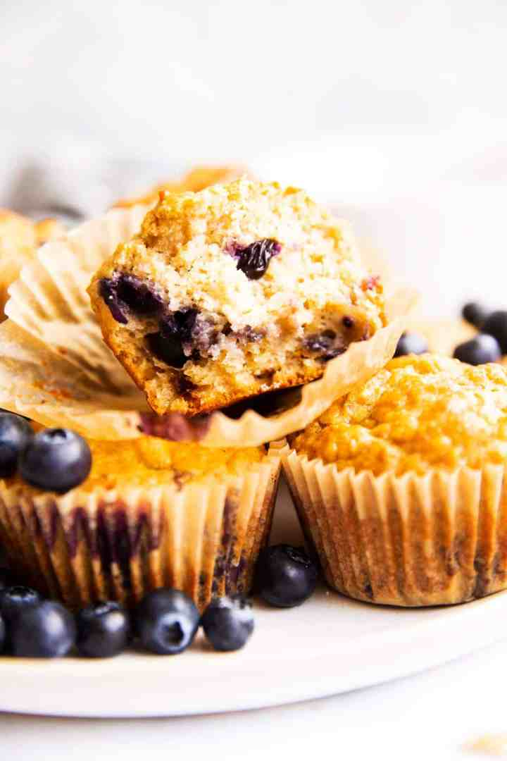frontal view of blueberry oatmeal muffin broken in half