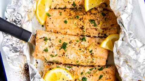 baking dish with lemon garlic butter salmon in foil