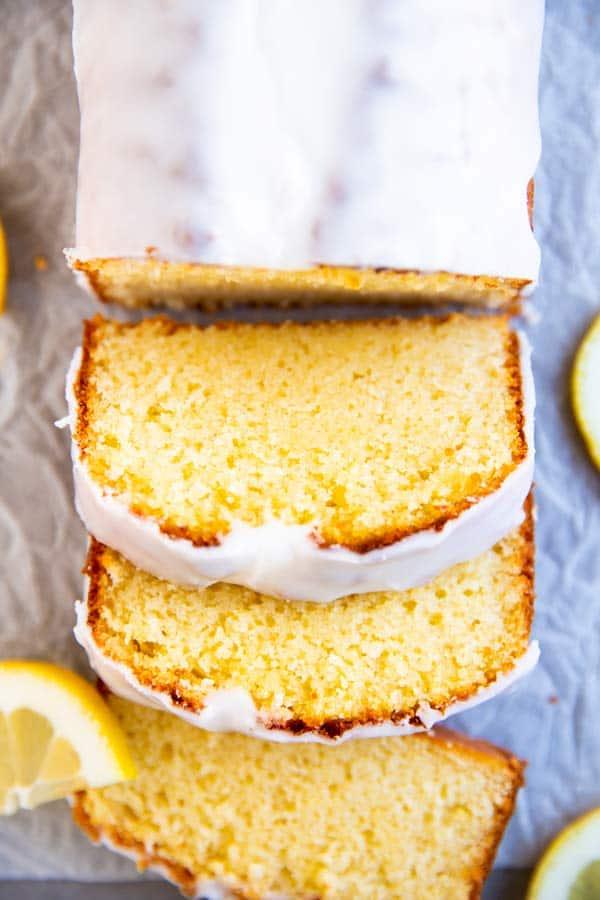 sliced lemon pound cake on parchment paper