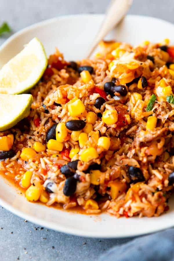 close up photo of a plate with mexican beef and rice skillet