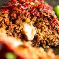 close up photo of mozzarella stuffed meatloaf