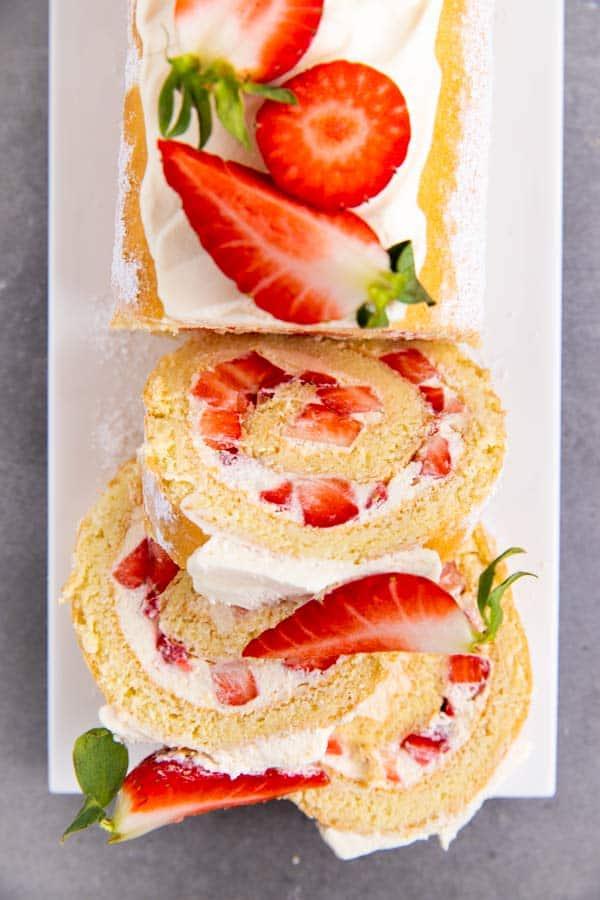 sliced strawberry cheesecake roll cake