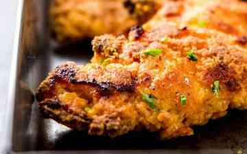 close up photo of a crispy oven fried buttermilk chicken piece