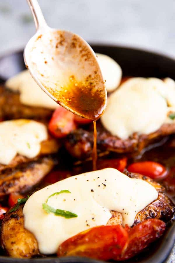 drizzling balsamic glaze over caprese chicken