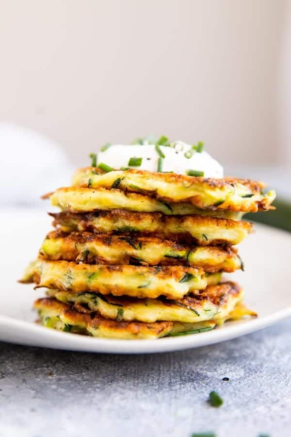 stack zucchini fritters on a plate