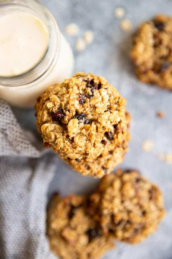 healthy oatmeal breakfast cookies on a table with a glass of milk