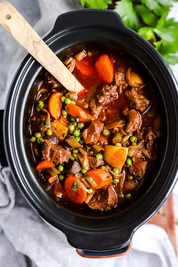 top down view of a black crock with beef stew