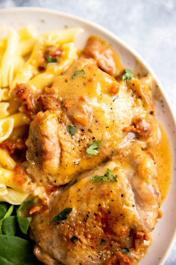 slice up photo of sun-dried tomato instant pot chicken thighs with pasta