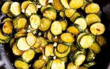 cast iron skillet with sautéed zucchini