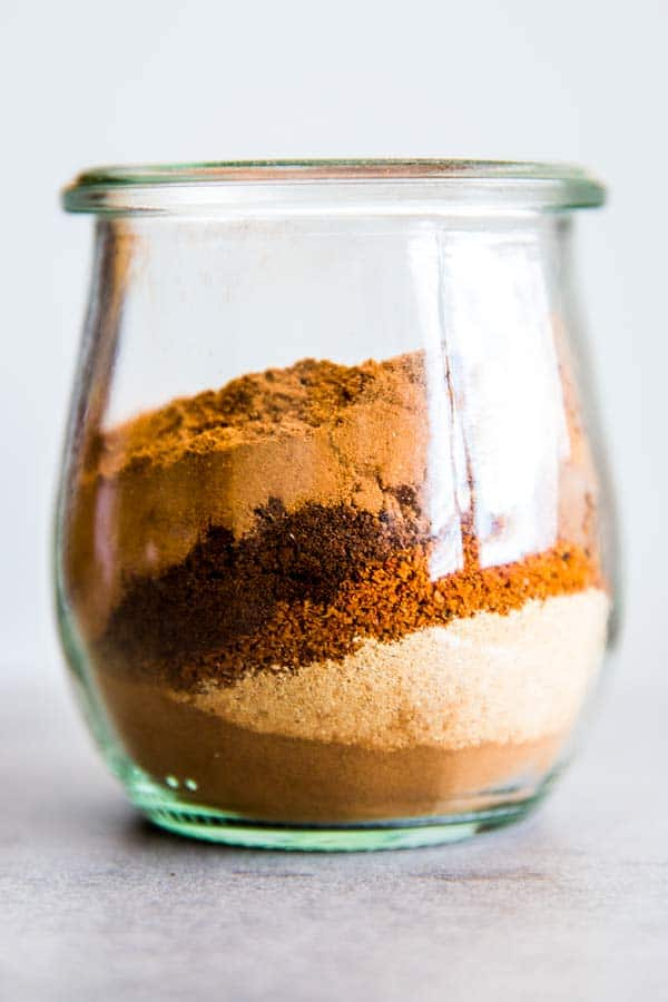 glass jar with spices for pumpkin pie mix
