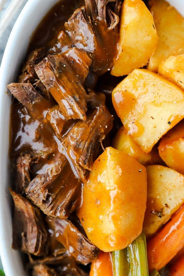 close up photo of instant pot pot roast with beef, carrots, celery and potatoes