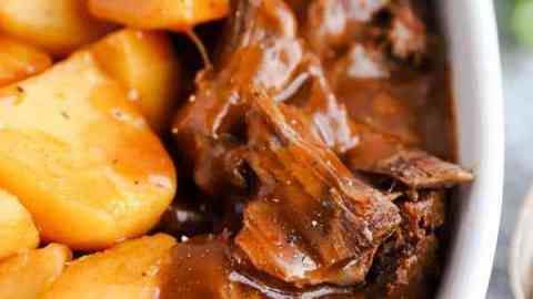 close up photo of an instant pot pot roast in a white dish