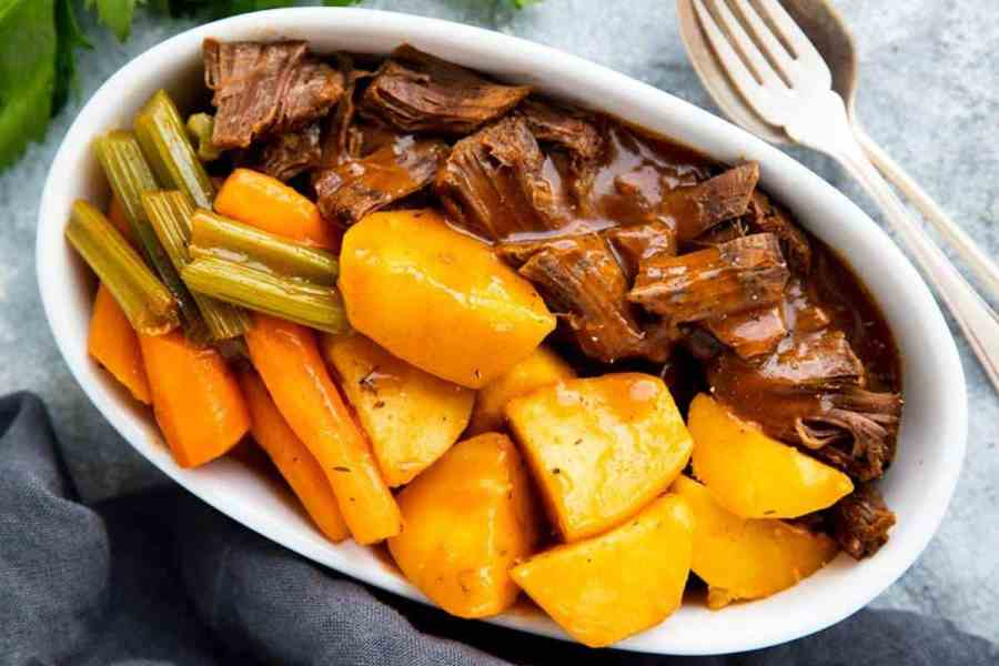 white dosh with beef roast, potatoes, carrots, celery and gravy