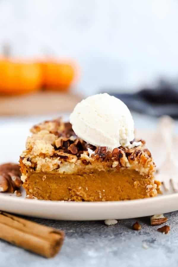 slice of pumpkin dump cake with a scoop of ice cream