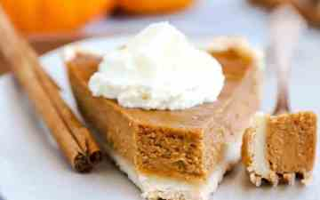 close up photo of a slice of pumpkin pie