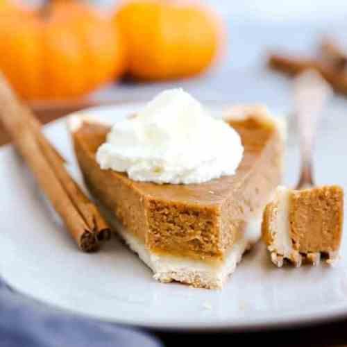 close up photo of a slice of pumpkin pie