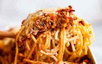 close up photo of a scoop of spaghetti casserole