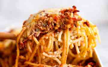 slice of spaghetti bake scooped out of casserole dish
