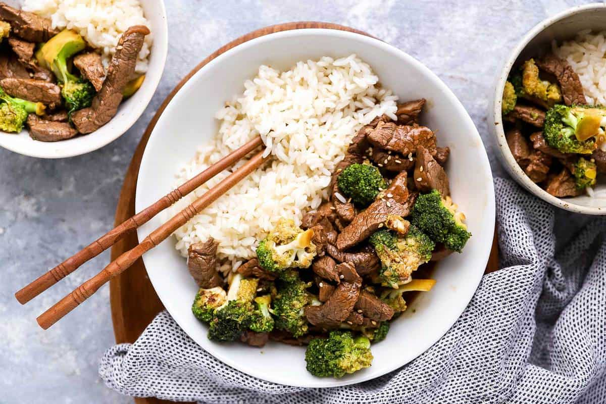 Three bowls with beef and broccoli and rice