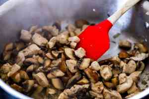 cooking mushrooms and chicken for a casserole