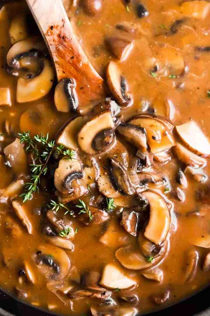 close up photo of mushroom gravy in skillet