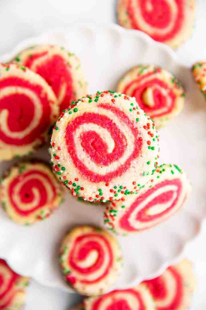 overhead view of Christmas Pinwheel Cookies on a white plate