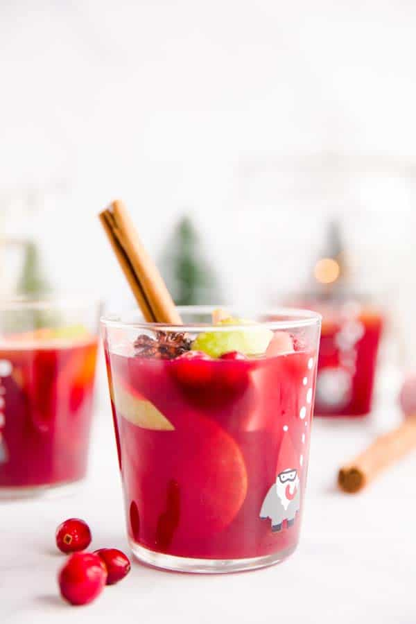 three glasses of Christmas punch on a table
