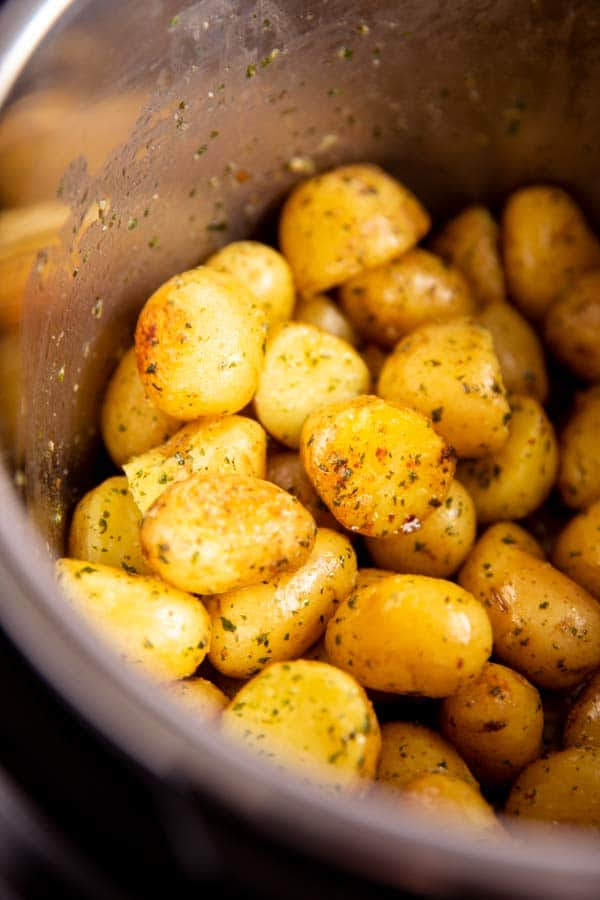 close up photo of buttery potatoes in an instant pot