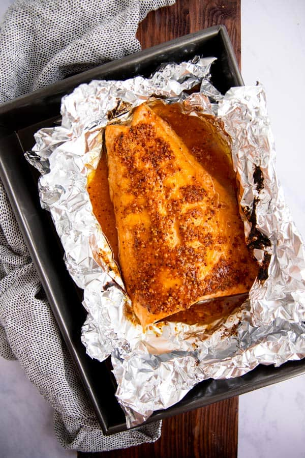 baking pan with foil and maple salmon