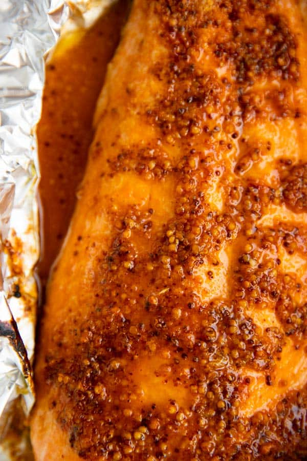 close up photo of baked salmon fillet in foil