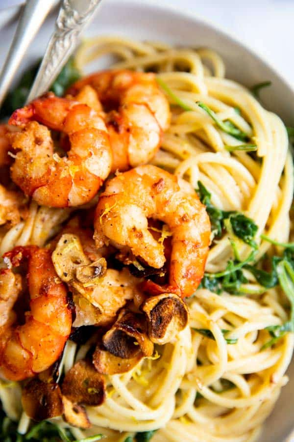 close up photo of shrimp on pasta