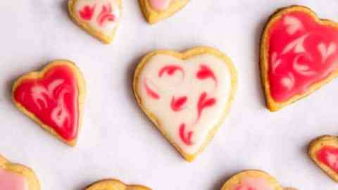 marble worktop covered in heart shaped cookies