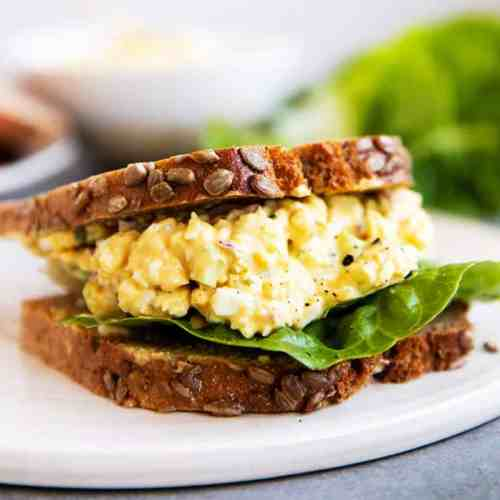 greek yogurt egg salad sandwich on a platter