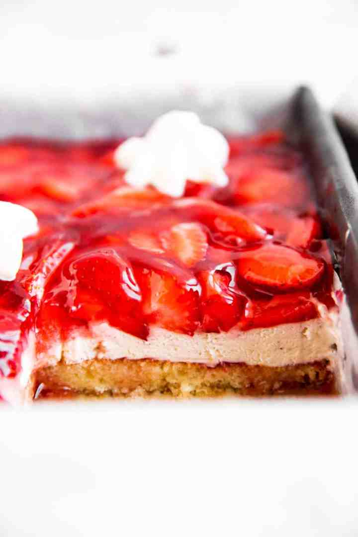 close up view of sliced strawberry cake in a pan