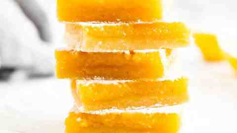 stack of lemon bars on a plate