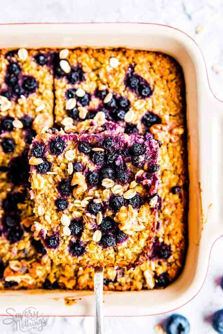 overhead view of blueberry baked oatmeal in white pan