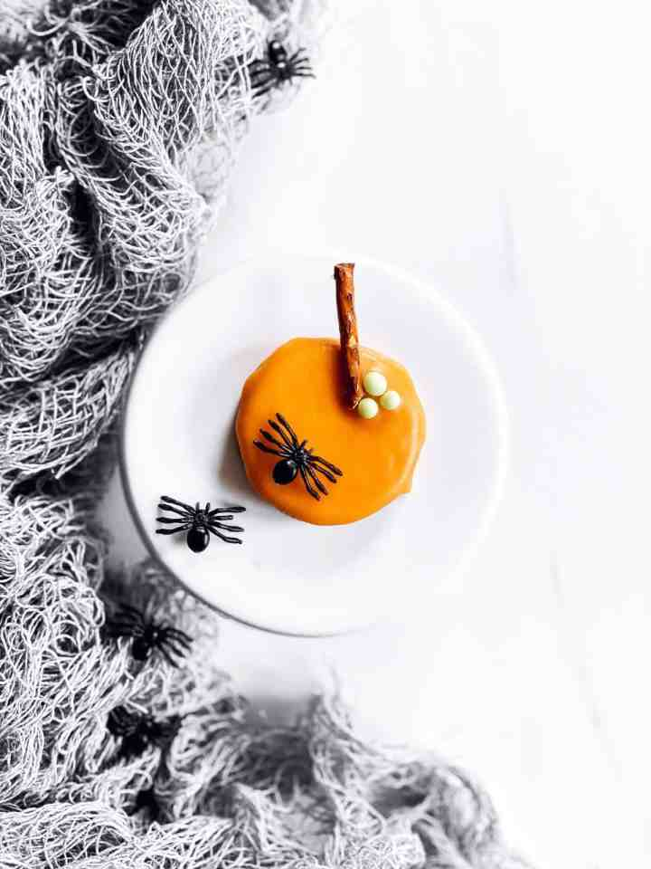 pumpkin decorated Oreo and miniature cake stand with plastic spiders