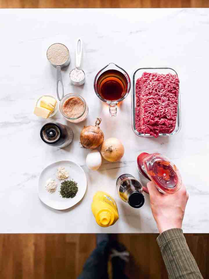 ingredients to make meatballs and gravy on a marble countertop