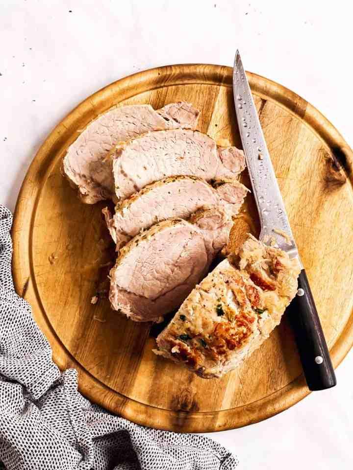 sliced pork and sauerkraut on wooden board