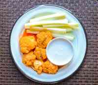 Air Fryer Buffalo Cauliflower Wings are quick and easy buffalo cauliflower bites appetizer to serve all year. They taste wonderful and are a great way to sneak in some veggies while enjoying the flavors you love. These vegan cauliflower wings not only easy to make, but are the perfect air fryer cauliflower appetizer you'll want to serve to your family and friends. These little air fryer wings are so worth the time and effort as they are crispy but yet tasty. You'll definitely not miss having chicken with these little cauliflower bites. Learn to make this vegan cauliflower recipe with just a few ingredients. I've even included on how to barbecue cauliflower wings. Cauliflower wings are Keto, Gluten-Free, Paleo, Low Carb, and satisfy Whole30 diets.