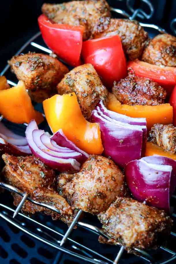 Air Fryer Grilled Chicken Skewers threaded in a pattern to be place in the air fryer basket.