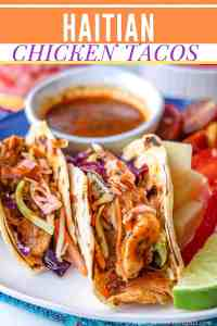 Insanely delicious Haitian Chicken Tacos that are loaded with juicy, slightly spicy tender chicken thigh strips, and topped with vibrant, refreshing pikliz as well as accompanied with marinated tomatoes. Perfect for Taco Tuesdays. Haitian Chicken   Mexican Meals   Chicken Tacos   Fusion Recipes   Savory Thoughts