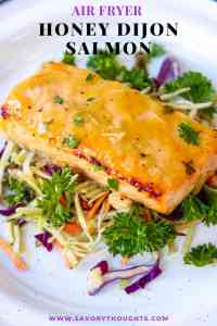 Honey Dijon Salmon - Air Fryer Recipe is a quick, easy, and a healthy weeknight dinner. A hearty baked salmon recipe that's fuss-free! Baked salmon fillet made in the air fryer to perfection. A flavorful simple meal that that's ready in 10 minutes. Dijon Salmon | Honey Mustard Glazed Salmon | Savory Thoughts #air fryer #honey #mustard #dijonmustard #recipes #paleo #honeymustardglaze #healthy #lemon. Honey Dijon Salmon - Air Fryer Recipe is a quick, easy, and a healthy weeknight dinner. A hearty baked salmon recipe that's fuss-free! Baked salmon fillet made in the air fryer to perfection. A flavorful simple meal that that's ready in 10 minutes. Dijon Salmon | Honey Mustard Glazed Salmon | Savory Thoughts #air fryer #honey #mustard #dijonmustard #recipes #paleo #honeymustardglaze #healthy #lemon