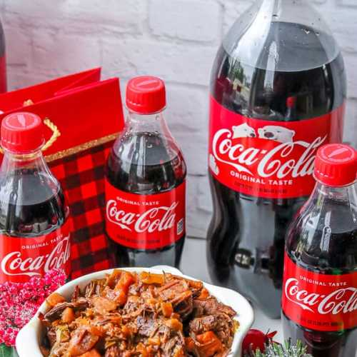 Chuck roast in white plate with Coca-Cola® bottles