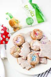 Holiday Molasses cookies on white plate with trivia package