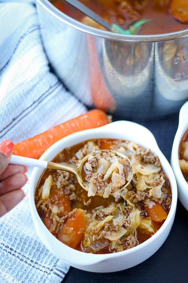 Instant Pot Cabbage Soup in white bowl and on spoon