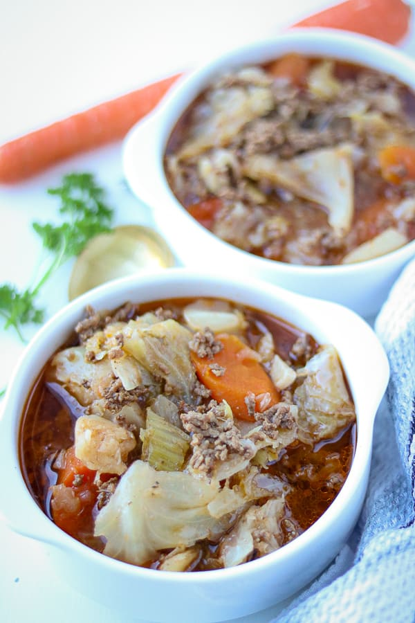 Stove top cabbage soup in white bowls