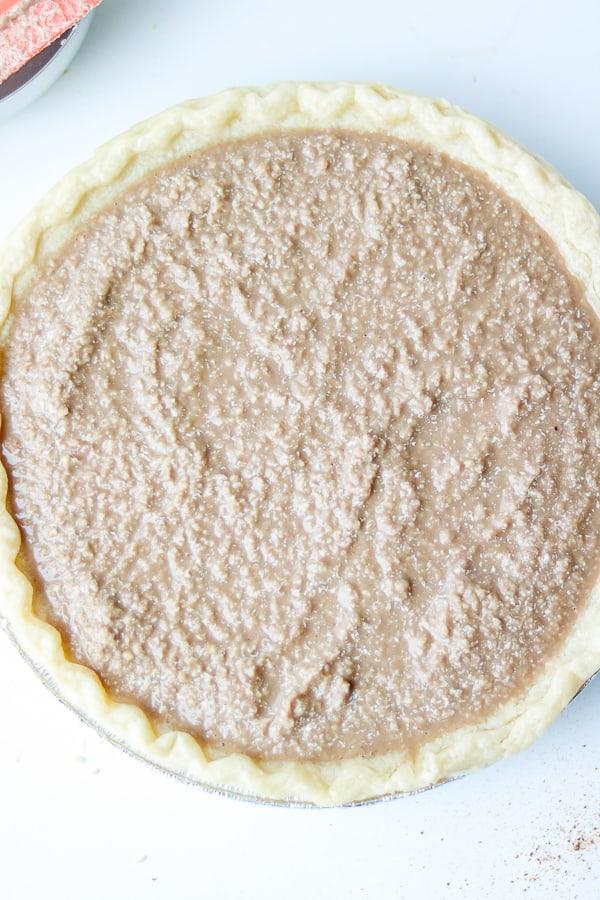 White sweet potato pie filling in crust