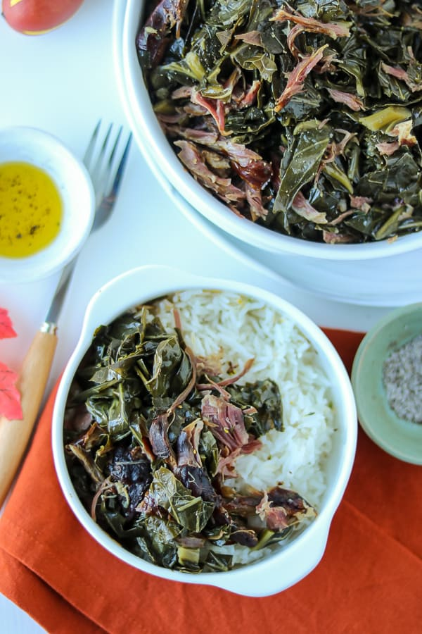 southern collard greens in white bowl with rice